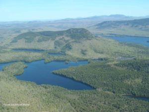 Aerial view of Little Greenwood Pond, Lake Onawa, Borestone Mountain, and Barren Mountain (traversed by the Appalachian Trail).
