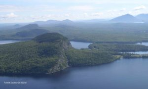 View of Mount Kineo and other conserved forestlands along Moosehead Lake.
