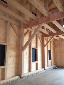 The inside of a timber frame building under construction. Photo by Erin Connolly.