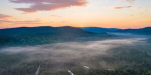 Sunrise over the Swift Cambridge River looking east over Popple Dam Rd in Grafton Township, Maine. Photo by Jerry Monkman, EcoPhotography.